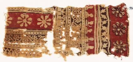 Textile fragment with bands of rosettes and vines