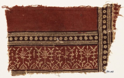 Textile fragment with plants, half-medallions, and bands of rosettes