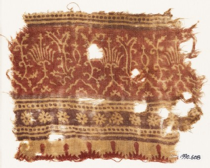 Textile fragment with stylized plants, half-medallions, rosettes, and crenellations
