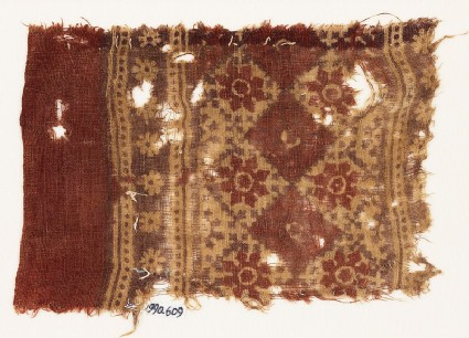 Textile fragment with grid of squares and rosettes