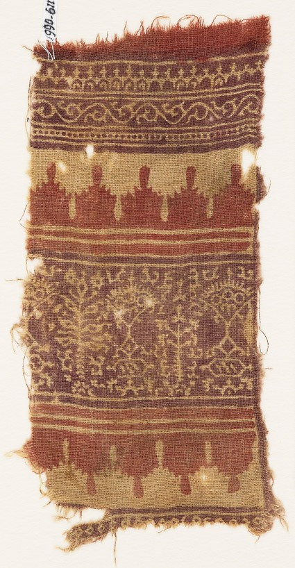 Textile fragment with bands of stylized trees, crenellations, vine, and arches