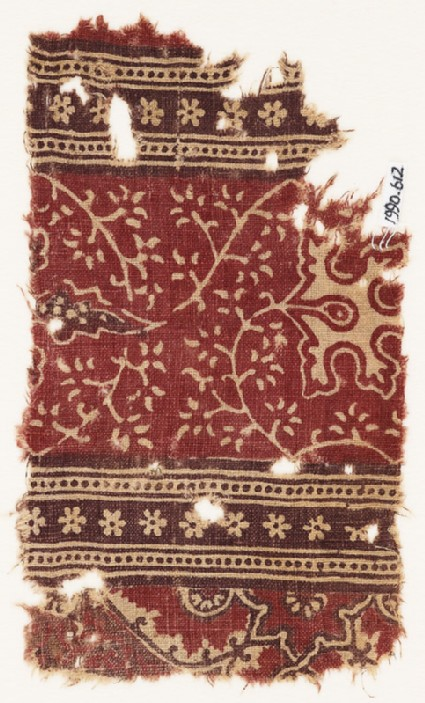 Textile fragment with stems, leaves, flowers, and rosettes
