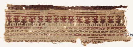 Textile fragment with wavy lines, dots, and possibly stylized trees