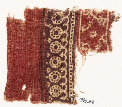 Textile fragment with bands of dotted circles, curves, and crossed tendrils
