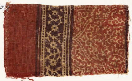 Textile fragment with tendrils, a half-medallion, and rosettes