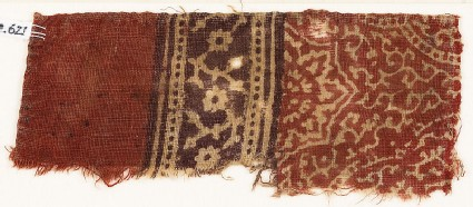 Textile fragment with tendrils, dotted frames, and rosettes