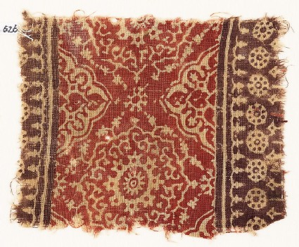 Textile fragment with ornate flower-heads, medallions, and dotted circles
