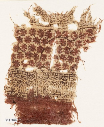 Textile fragment with arches and rosettes