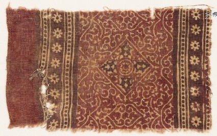 Textile fragment with tendrils, square, and rosettes