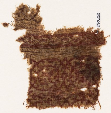 Textile fragment with vines forming circles