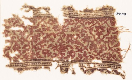 Textile fragment with interlacing vines, leaves, and flower-heads