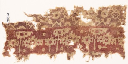 Textile fragment with serrated shapes, rosettes, and squares