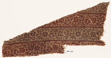 Textile fragment with vines, leaves, and flowers, probably from a garment