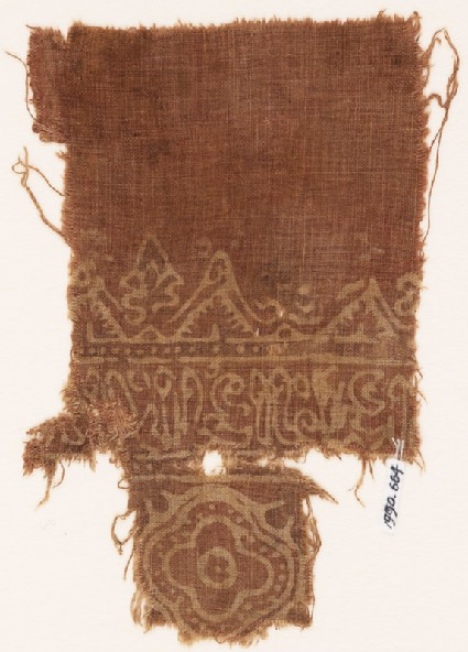 Textile fragment with medallion and reversed script