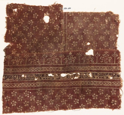 Textile fragment with flowers, cable pattern, stylized plants, and Arabic inscription