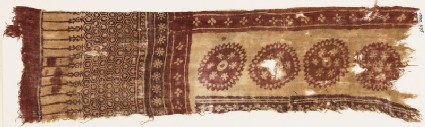 Textile fragment with large circles, flowers, and hexagons