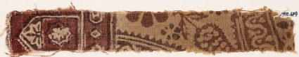 Textile fragment with floral design, small cartouches, and a tab-shape