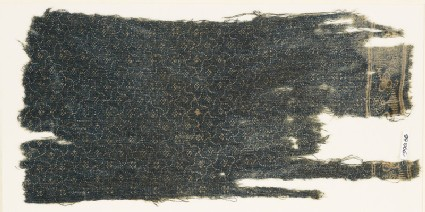 Textile fragment with rosettes and grid of four-pointed shapes