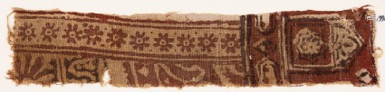 Textile fragment with rosettes, small cartouches, and a tab-shape
