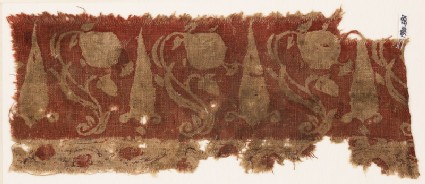 Textile fragment with large flowers, undulating stems, and possibly stylized leaves