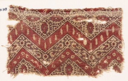 Textile fragment with chevrons, hexagons, and flowers