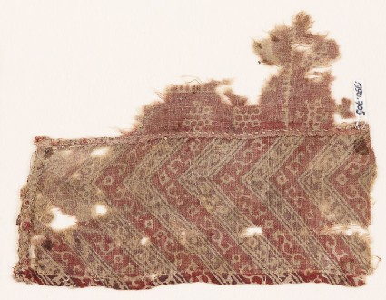 Textile fragment with chevrons, flowers, and snowflakes
