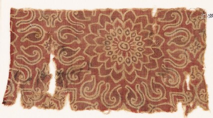Textile fragment with an elaborate rosette and leaves