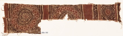Textile fragment with squares, circles, and rosettes