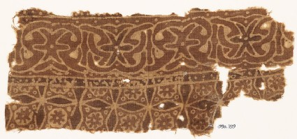 Textile fragment with interlace and four-pointed stars