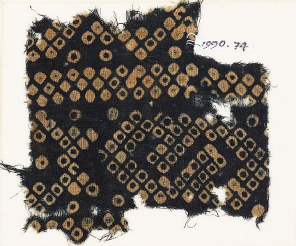 Textile fragment imitating bandhani, or tie-dye, with inverted hooks