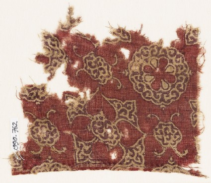 Textile fragment with quatrefoil, lobed disc, and medallions