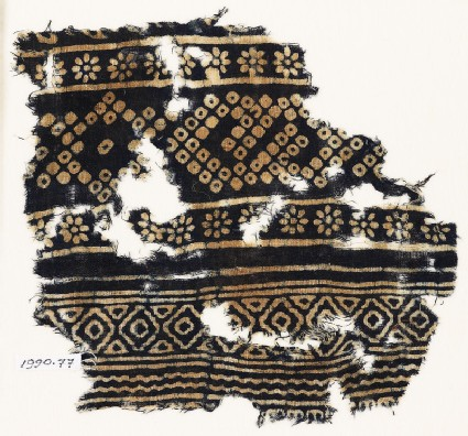 Textile fragment with rosettes and bandhani, or tie-dye, imitation