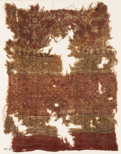 Textile fragment with bandhani, or tie-dye, imitation and interlace medallions