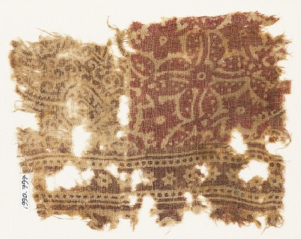 Textile fragment with quatrefoil, stylized stem, and leaf