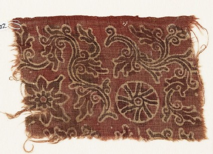 Textile fragment with curving vines, quatrefoil, and rosette