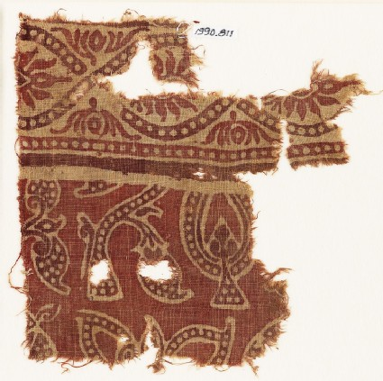 Textile fragment with dotted leaves, interlace, and flowers