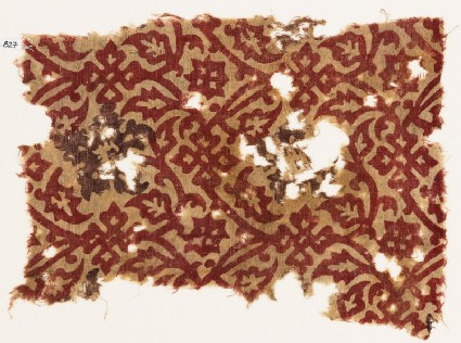 Textile fragment with interlacing tendrils, leaves, and flowers