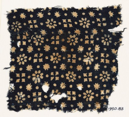 Textile fragment with rosettes, dots, floral shapes, and squares
