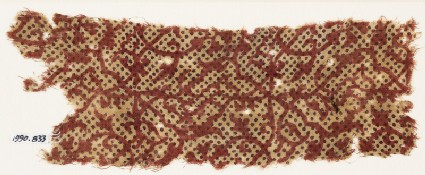 Textile fragment with interlacing tendrils and dots