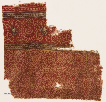 Textile fragment with tendrils, flowers or fruit, and rosettes