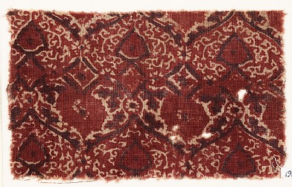 Textile fragment with heart-shaped flower-heads and tendrils
