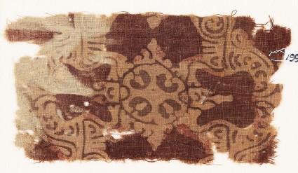 Textile fragment with ornate quatrefoil or medallion
