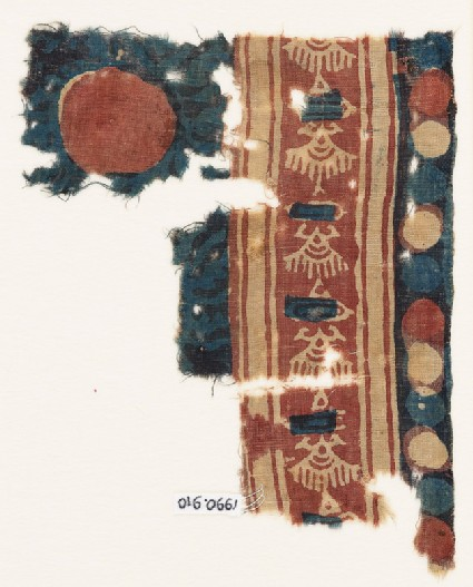 Textile fragment with stylized shapes, possibly birds