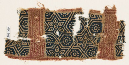 Textile fragment with stars and hexagons