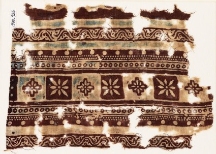 Textile fragment with bands of squares, diamond-shapes, and rosettes