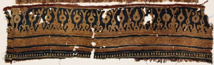 Textile fragment with stylized trees and rosettes