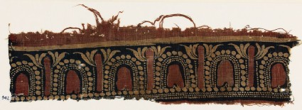 Textile fragment with stylized trees and arches