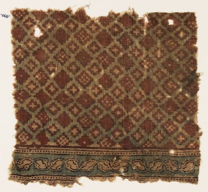 Textile fragment probably imitating patola pattern, with a grid of stepped diamond-shapes