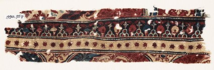 Textile fragment with flowers or stars, trefoils, and circles