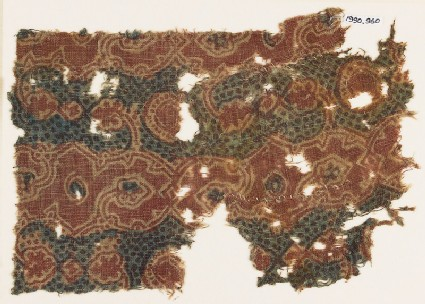 Textile fragment with tendrils and vine leaves